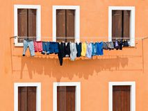 Windows with washing hung on drying Royalty Free Stock Photos