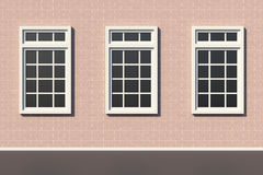 Windows on white brick wall Royalty Free Stock Image