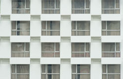 Windows on the white building. Some windows is open the curtain Royalty Free Stock Image