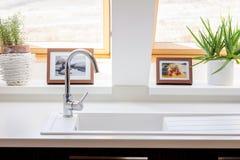 Windows in white contemporary kitchen Stock Image