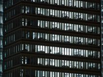 Windows of white lit offices in tall Office building royalty free stock photo