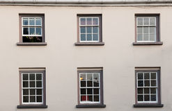 Windows on a white wall. Royalty Free Stock Photos