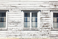 Windows in a white wooden house Stock Images