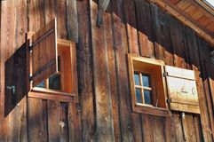 Windows on wooden cottage Royalty Free Stock Image