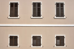 Windows with wooden jalousies Stock Photo