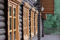 Windows. Wooden Russian house with old windows in the summer royalty free stock images