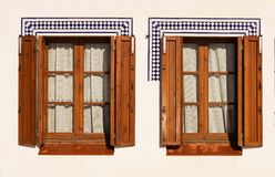 Windows with wooden shutters. Stock Images