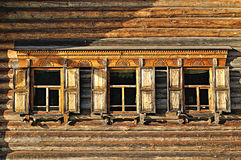 Windows of wooden traditional Russian house built in Russian country style Royalty Free Stock Photo