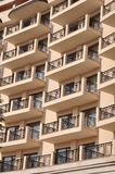 Windows and yellow balconies Royalty Free Stock Photos