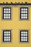 Windows on a yellow facade Royalty Free Stock Photo