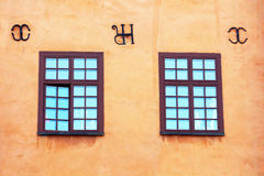 Windows of yellow iconic buildings on Stortorget stock photo