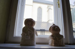 Windowsill with Christmas angels. Windowsill with two Christmas angels royalty free stock photos