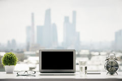 Windowsill with laptop Royalty Free Stock Photography