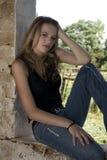 Windowsill teenager Royalty Free Stock Images