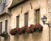 Windowsills in Old Quebec. Windowsills adorned with flowers in Old Quebec, Canada Stock Photo