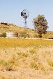 Windpump and dam in the Kalahari desert. Windpump and man made dam in the Kalahari desert Royalty Free Stock Images