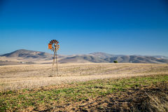 Windpump and hills Stock Images