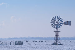 Windpump in winter landscape Stock Image