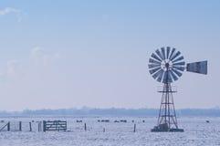 Windpump in winter landscape. Windpump in a snowy winter landscape Stock Image