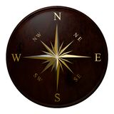 Windrose. Brass compass windrose in marine style on a wooden disk Royalty Free Stock Images