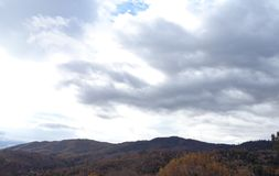 Winds of Change: Autumn Rainstorm Rising Over Mountain Ridge Royalty Free Stock Photography