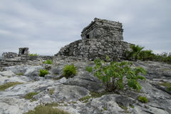 Winds God Temple at Tulum. Photo of the Winds God Temple at the edge of cliff overlooking the Caribbean Sea at Mayan ruins site in Tulum Mexico stock photography