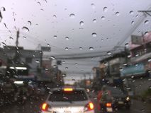 Windscreen Blurry View of Traffic Jammed in Rainy Season. Thailand Royalty Free Stock Photos
