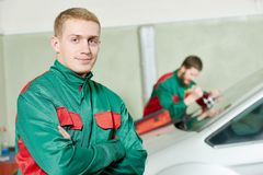 Windscreen repairman workers Royalty Free Stock Photos