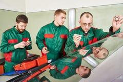 Windscreen repairman workers Royalty Free Stock Image