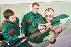 Windscreen repairman workers Stock Images
