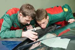 Windscreen repairman workers Stock Photo