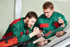Windscreen repairman workers Stock Image