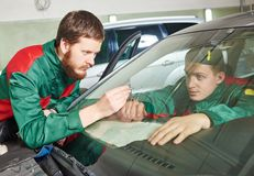 Windscreen repairman workers Stock Image