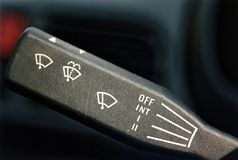 Windscreen wipers. Windscreen wiper stalk showing symbols for off, intermediate and different speeds Stock Images