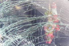 Windshield cracked. From the accident with garlands inside royalty free stock image