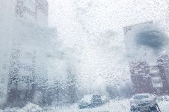 Windshield from inside the car during heavy snowfall stock photography