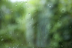 Windshield during rain with green background Royalty Free Stock Image