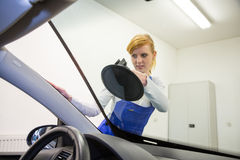Windshield replacement by glazier in garage Stock Photo
