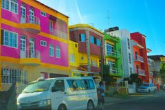 Cape Verde Capital City Windshield View, Colorful Neighborhood Street, Collective Transportation, Inside Car,. November 2016: Collective transportation stoped on Royalty Free Stock Photo