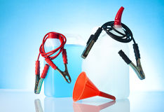Windshield washer fluids and jump start cables with funnel Stock Photography