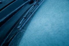 Windshield wiper ice. Ice stuck on a windshield of a car during winter Royalty Free Stock Images