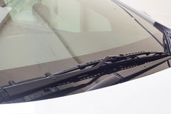Windshield wiper in rain car. Windshield wiper in rain car lihgt Stock Photos