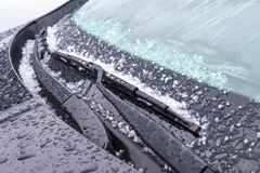 Windshield wiper with rain drops and ice stock image