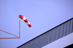Windsock über Geländer Lizenzfreies Stockbild