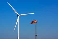 Windsock. In front of a wind power energy turbine Stock Images