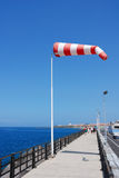 Windsock. At boardwalk of harbor Royalty Free Stock Photos
