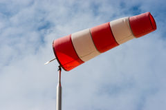 Windsock against a blue sky. Windsock to indicate the direction of the wind Stock Image
