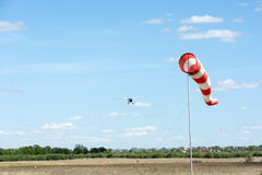 Windsock against cloudy sky. Royalty Free Stock Photography