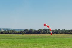 Windsock as a gauge for winds, wind vane on aerodrome airfield on an air show. Windsock as a gauge for winds, wind vane on the aerodrome airfield on an air show stock image