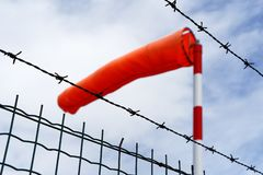Windsock behind barbed wire royalty free stock photography